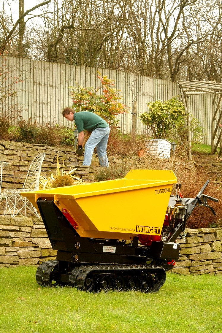 Winget TD500HL machinery in garden with man in background